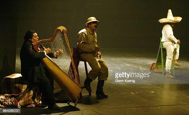 left to right Harpist Ricardo Silva Heriberto Norzagaray as Francisco Poncho Villa and Andrès Garcia Moreno as Emiliano Zapata during a performance...