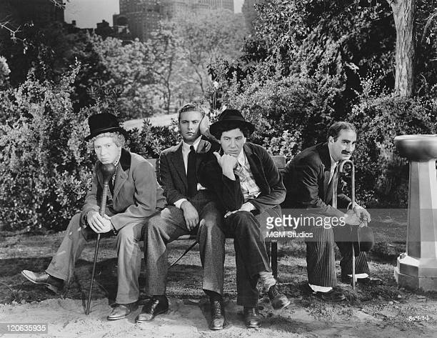 Harpo Marx Allan Jones Chico Marx and Groucho Marx in a scene from 'A Night At The Opera' directed by Sam Wood 1935