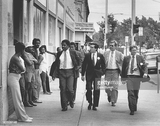 AUG 28 1985 Left to right Hiawathea Davis Mayor Pena one of Pena's Guards and to the far right Dennis Frank with the Community Development Agency...
