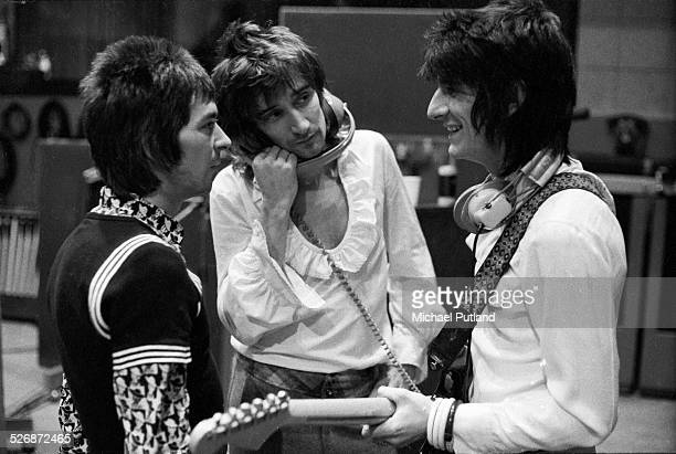 Ian McLagan Rod Stewart and Ronnie Wood of The Faces during a recording session in London October 1974