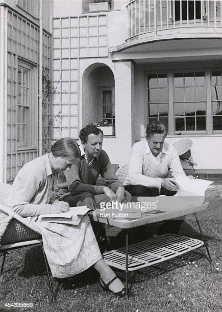 Imogen Holst fellow composer and conductor Benjamin Britten and tenor Peter Pears discussing Britten's opera 'Billy Budd' in a garden at Aldeburgh...