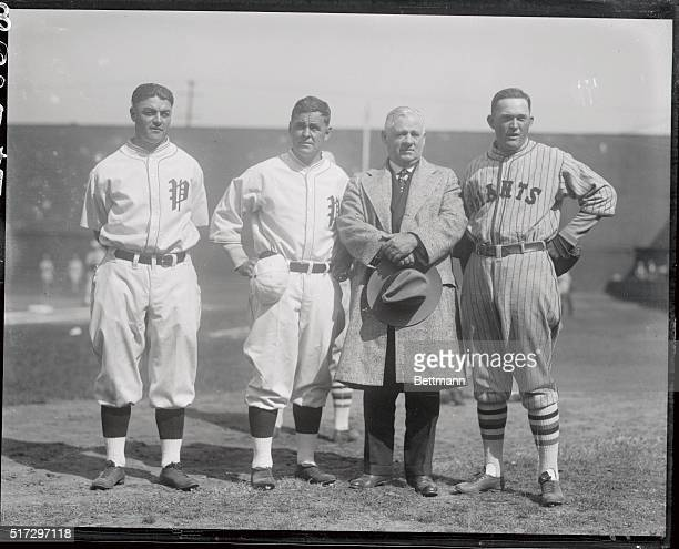 Left to right is captain Hack Wilson and manager Stuffy McInnis of the Philadelphia team and John McGraw and Rogers Hornsby manager and captain of...