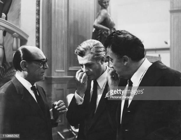 Italian actors Mino Doro and Marcello Mastroianni with director Federico Fellini on the set of '8 1/2' 1963