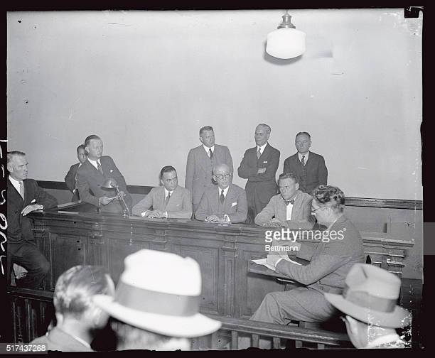 Left to right J Edgar Hoover head of the Department of Justice General John J O'Ryan Police commissioner of New York and Colonel Norman Schwartzkopf...