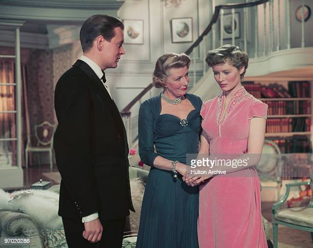 Jack Watling Heather Thatcher and Virginia McKenna in a scene from the British comedy film 'Father's Doing Fine' directed by Henry Cass 1952