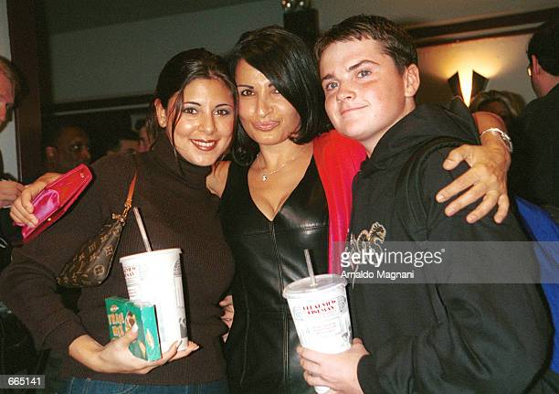 Left to right Jamie Lynn Sigler Kathrine Narducci and Robert Iler pose for photographers at the premiere of Sundance 2000 Audience Award winner Two...