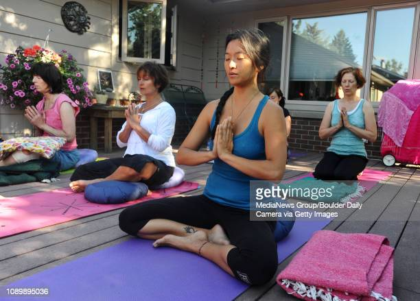Left to right, Janet Jacobs, Shelley Kappel Kyahnasun Ekatvam and Louise Ross take part in a Yoga on the Lawn class taught by Cindy Lawrence.