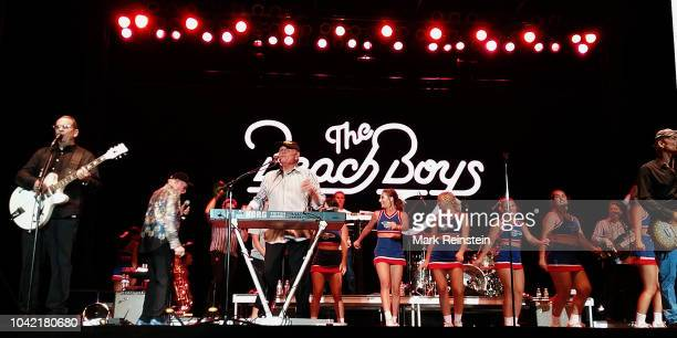 Left to right, Jeffrey Foskett on guitar, Mike Love on vocals, Bruce Johnston on the keyboards, and Christian Love on guitar share the stage with the...