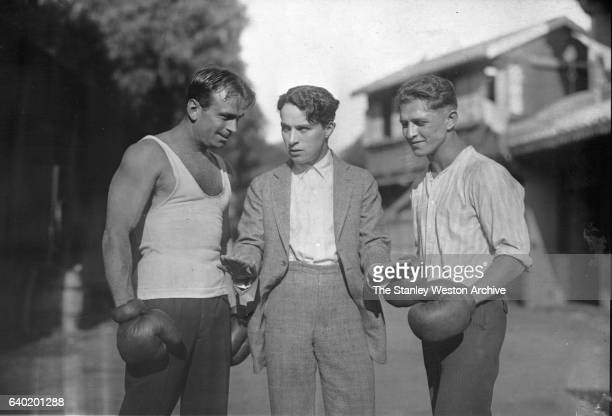 Left to Right: Joe Benjamin the contender for Benny Leonard's Lightweight Title, Charlie Chaplin, and Douglas Fairbanks Sr., in Hollywood,...