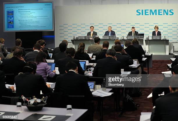 Joe Kaeser chief financal officer of Siemens AG Peter Loescher the company's chief executive officer Stephan Heimbach the company's head of...