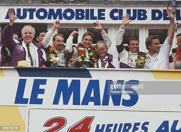 Left to right John Egan chief executive of Jaguar Cars Johnny Dumfries Jan Lammers and Andy Wallace drivers of the Silk Cut Jaguar XJR9 LM and Tom...