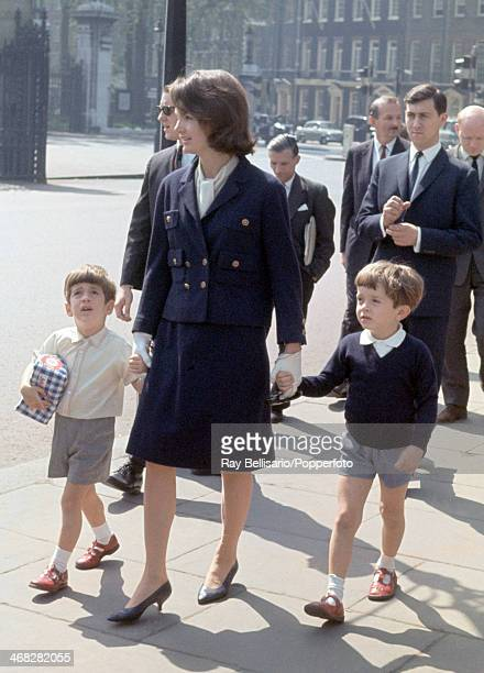 Left to right John F Kennedy Junior son of the late United States president Jacqueline Kennedy the president's widow and Anthony Radziwill her nephew...