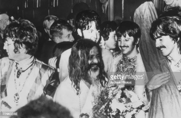 John Lennon Paul McCartney Ringo Starr and George Harrison of the Beatles among the devotees at a transcendental meditation course in Bangor North...