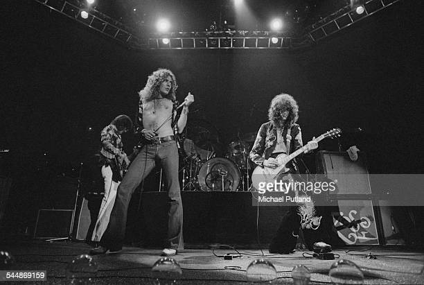John Paul Jones Robert Plant and Jimmy Page of British heavy rock group Led Zeppelin performing at Earl's Court London May 1975 The band were...
