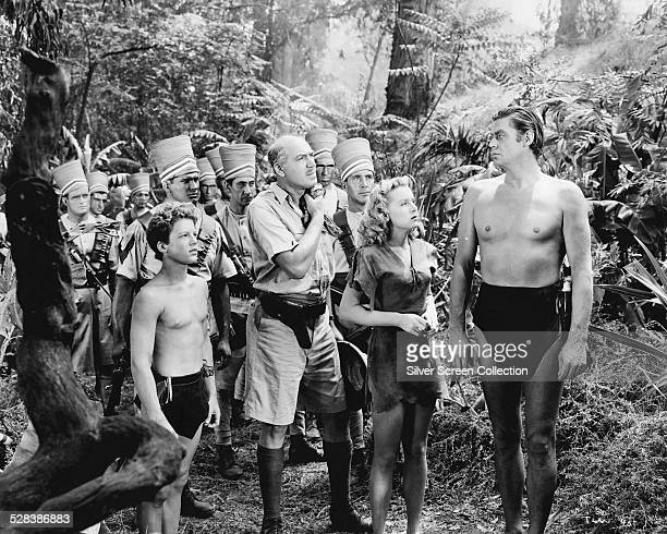 Johnny Sheffield as Boy Dennis Hoey as the Commissioner Brenda Joyce as Jane and Johnny Weissmuller as Tarzan in 'Tarzan And The Leopard Woman'...