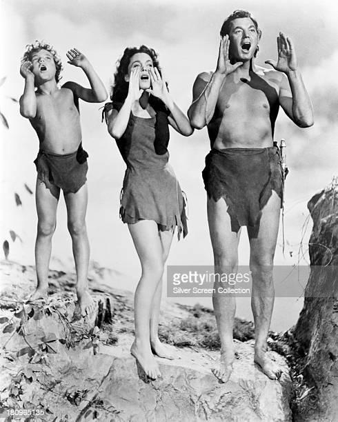 Johnny Sheffield as Boy Maureen O'Sullivan as Jane Parker and Johnny Weissmuller as Tarzan in a promotional still for 'Tarzan's Secret Treasure'...