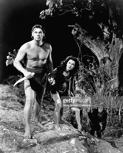 Johnny Weissmuller as Tarzan Maureen O'Sullivan as Jane Johnny Sheffield as Boy and Cheeta the chimp in 'Tarzan's New York Adventure' directed by...