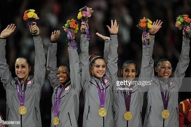 Jordyn Wieber Gabrielle Douglas Mc Kayla Maroney Alexandra Raisman and Kyla Ross USA Women's Gymnastic team celebrate winning the Gold Medal during...