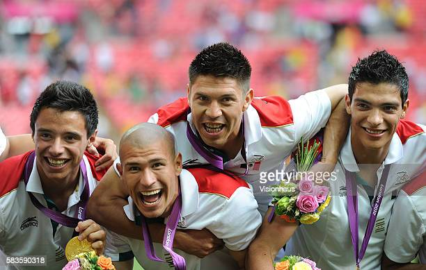 Jose Rodriguez Jorge Enriquez Orobe Peralta and Raul Jimenez of Mexico celebrate winning the gold medal after victory during the Brazil vs Mexico...
