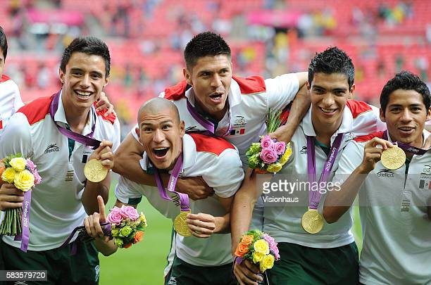 Jose Rodriguez, Jorge Enriquez, Orobe Peralta, Raul Jimenez and Javier Aquino of Mexico celebrate winning the gold medal after victory during the...