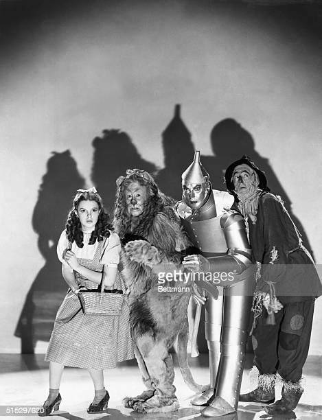 Judy Garland Bert Lahr Jack Haley and Ray Bolger dressed in character as Dorothy Gale Cowardly Lion Tin Man and Scarecrow from the film The Wizard of...