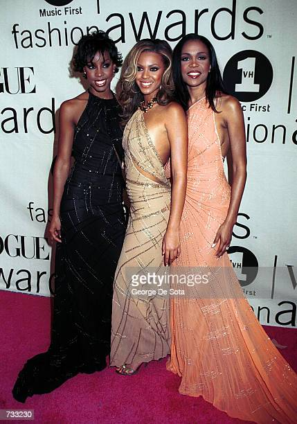 Left to right Kelly Rowland Beyonce Knowles and Michelle Williams of Destiny's Child pose for photographers backstage at the VH1 2000 Fashion Awards...