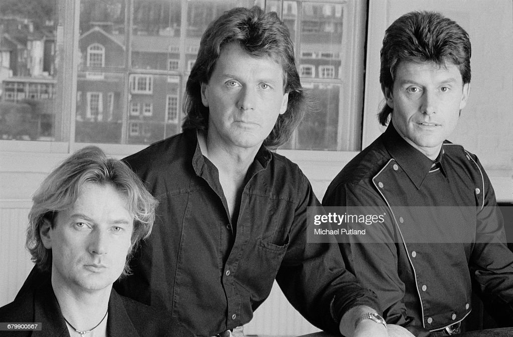 Left to right; keyboard player Geoff Downes, bassist John Wetton (1949 - 2017) and drummer Carl Palmer of English progressive rock band Asia, London 1990.