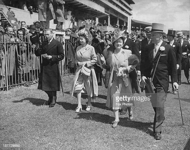 King George VI Princess Elizabeth Queen Elizabeth and Bernard FitzalanHoward 16th Duke of Norfolk at the Oaks Stakes Epsom Downs Racecourse Surrey...