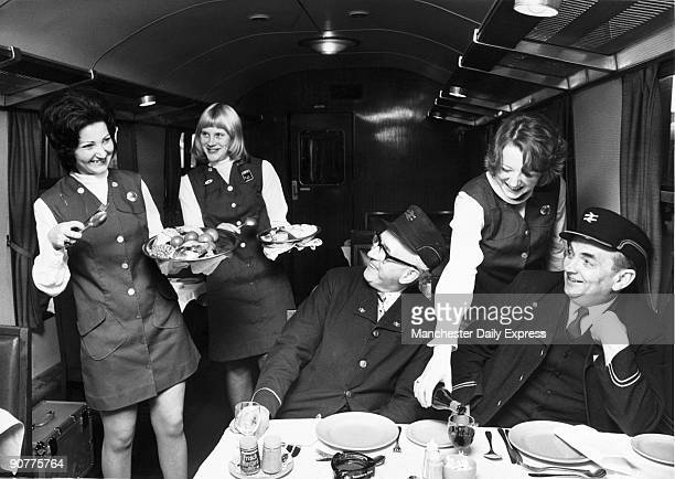 Left to right Marie Spencer Dianna Bunyan and Margaret Liddle practising serving meals to BR workers George West cleaning supervisor and Ernest...