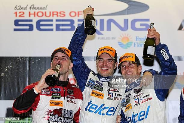 Left to right Marino Franchitti Memo Rojas and Scott Pruett celebrate after winning the 12 Hours of Sebring at Sebring International Raceway on March...