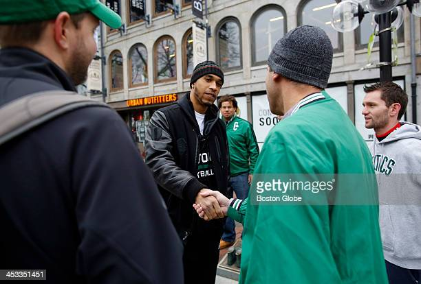 Left to right Mark VanDeusen of Concord looks on as Boston Celtics player Courtney Lee shakes hands with Anthony Pappalardo of Dracut as Mark Johnson...
