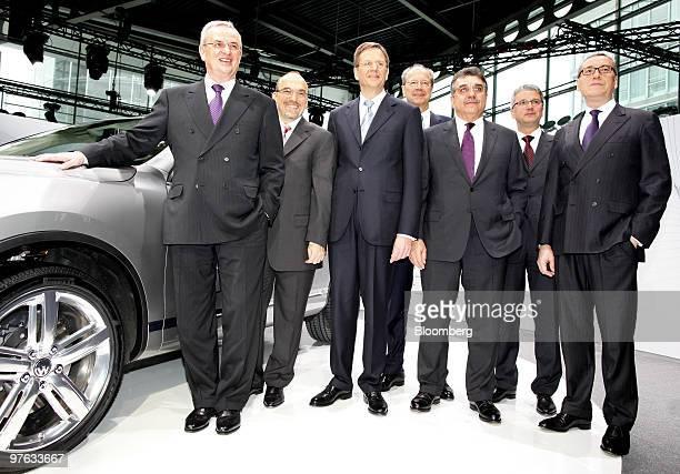 Martin Winterkorn, chief executive officer of Volkswagen AG, Christian Klingler, head of sales and marketing at Volkswagen AG, Jochen Heizmann, head...