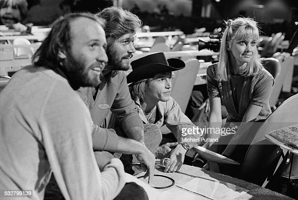 Maurice Gibb and Barry Gibb of the The Bee Gees with their younger brother Andy Gibb and Olivia NewtonJohn at 'The Music for UNICEF Concert A Gift of...