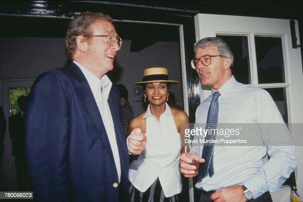 Michael Caine Shakira Caine and British Prime Minister John Major at the first match to be played at John Paul Getty Jr's new cricket ground on his...