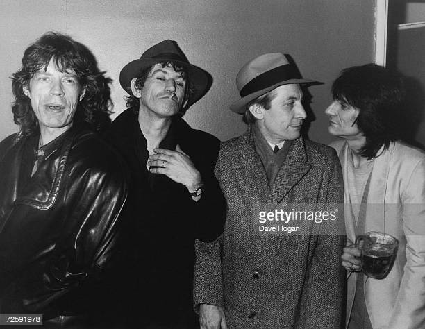 Mick Jagger, Keith Richards, Charlie Watts and Ron Wood of the Rolling Stones at the 100 Club in London's Tottenham Court Road, 24th February 1986.