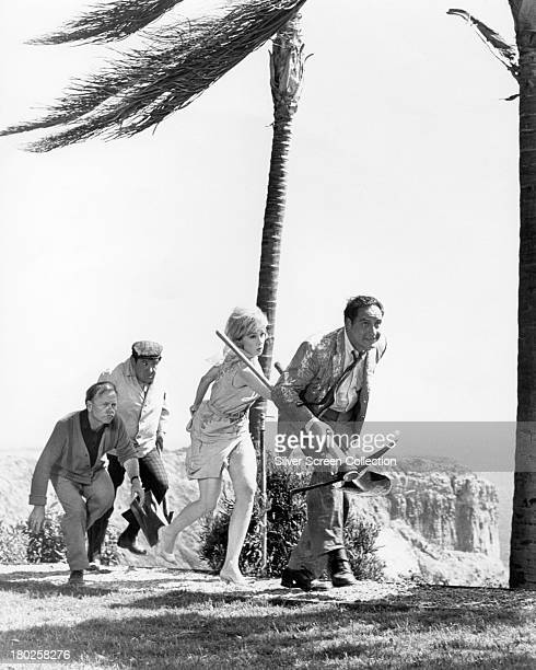 Mickey Rooney Buddy Hackett Edie Adams and Sid Caesar in 'It's A Mad Mad Mad Mad World' directed by Stanley Kramer 1963