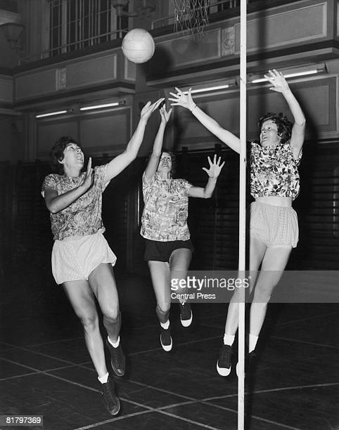 Mirth Te Moananui Judy Blair and Colleen McMaster of the New Zealand Girl's Netball Team practising at the Regent Street Polytechnic London 18th July...