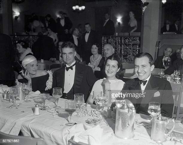 Miss Eleanor Holm Howard Hughes millionaire film producer and aviator Sandra Shaw and Carl Laemmle Jr Miss Holm is shown wearing a dress of black...