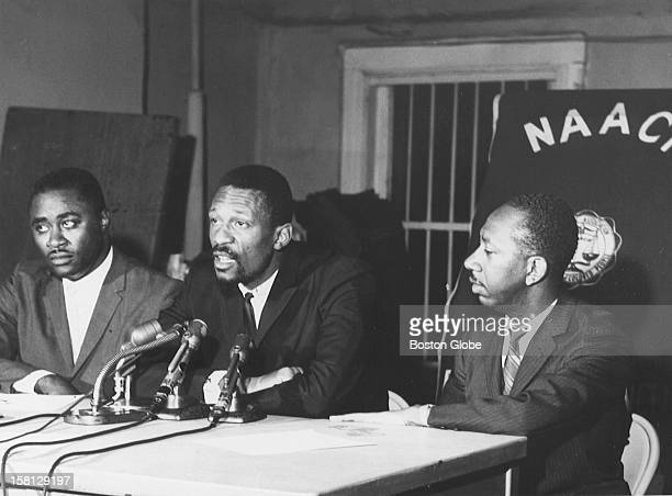Left to right Mr Kenneth Guscott Boston Celtics player Bill Russel and Marvin Gilmore speak at the NAACP Headquarters July 8 1964