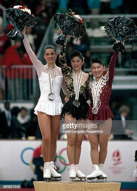 Nancy Kerrigan of the United States Kristi Yamaguchi of the United States and Midori Ito of Japan medallists in the ladies figure skating event...