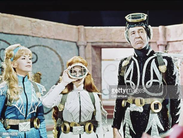 Nanette Newman, Luciana Paluzzi and Robert Ryan in a scene from James Hill's science fiction film 'Captain Nemo and the Underwater City', 1969.