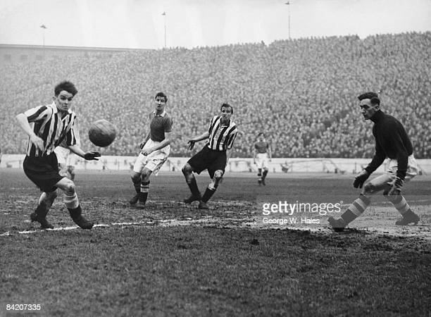 Newcastle insideright Davies about to intercept the ball Wicks of Chelsea Newcastle centreforward Keeble and Chelsea goalkeeper Charlie Thomson...