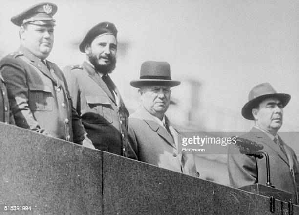 Left to right on the stand of the Lenin Mausoleum in Moscow's Red Square watching the May Day procession pass by are E Navarro Marshal Malinovsky...
