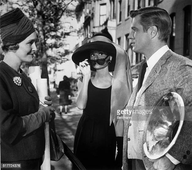 Patricia Neal Audrey Hepburn and George Peppard in a scene from the movie Breakfast at Tiffany's 1961