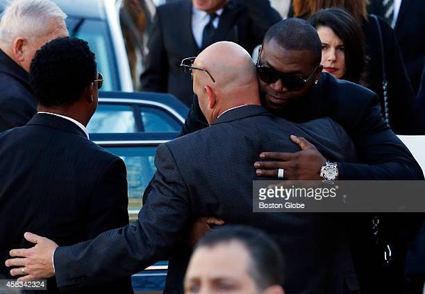 Left to right Pedro Martinez stands besideThomas Menino Jr center as he is embraced by David Ortiz after the funeral for Mayor Thomas Menino in Hyde...
