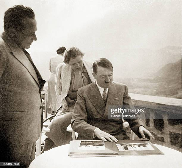 photographer Heinrich Hoffmann Eva Braun and Adolf Hitler at Hitler's residence the Berghof near Berchtesgaden Germany 1942 Hitler and Braun are...