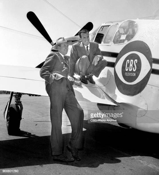 Left to right pilotactor Jimmy Stewart and Pilot Joe De Bona and with a P51 Mustang airplane They prep in advance to transport CBS News film of the...