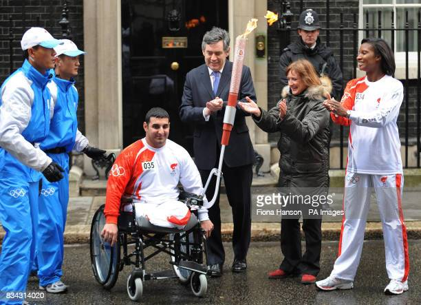 Left to right. Power-lifter Ali Jawad, now holding the Olympic torch, Prime Minister Gordon Brown, Minister for the Olympics Tessa Jowell and British...