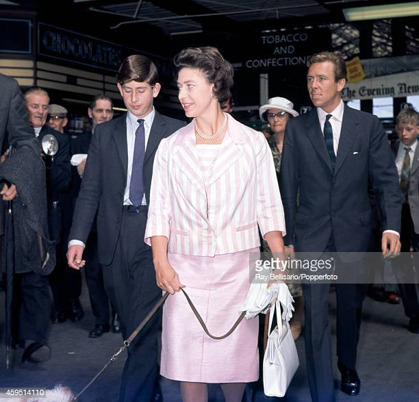 Left to right Prince Charles Princess Margaret with a dog on a lead and Anthony ArmstrongJones at Liverpool Street Station in London on 5th August...