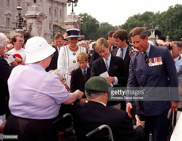 Princess Diana Prince Harry Prince William and Prince Charles meeting old soldiers on a walkabout outside Buckingham Palace London during VJ Day...